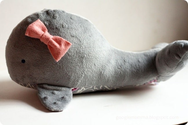 gray minky whale stuffed animal with pink bow