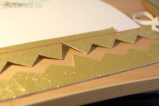 sparkly gold felt being cut into crown shape