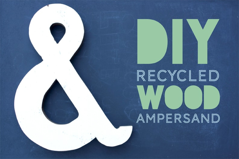 recycled wood ampersand on blue background