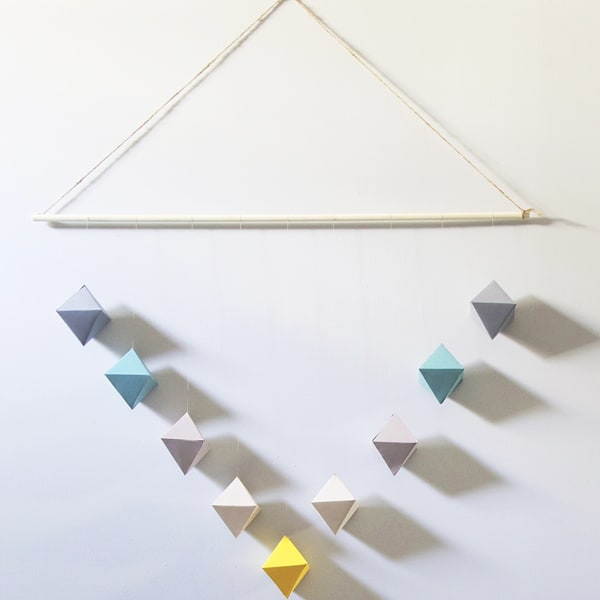 wall hanging made from paper geometric shapes
