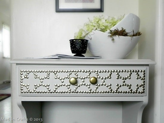 table with a drawer and nailhead design