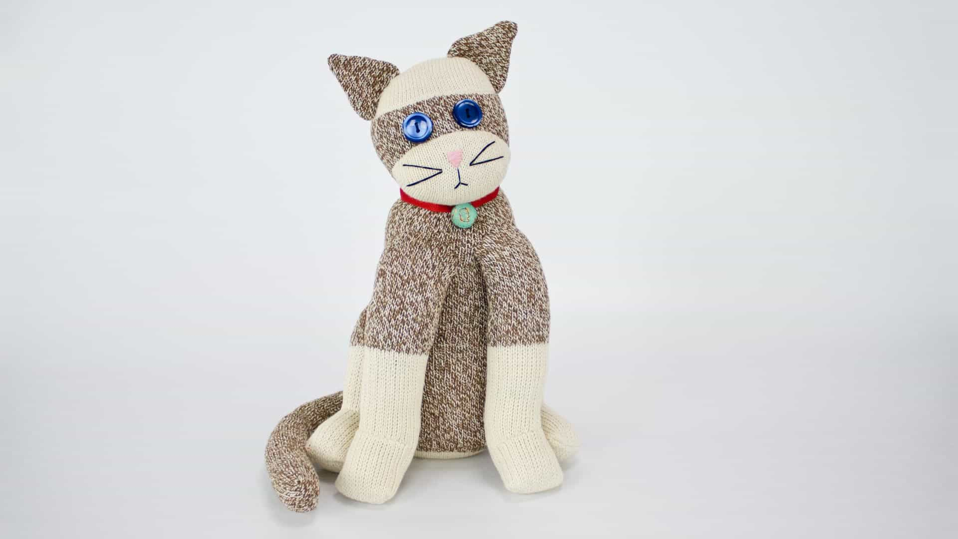 cat stuffed animal made from white and tweed socks