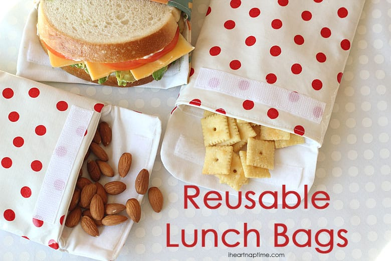 red and white polka dot fabric sandwich bags with velcro and snacks and a sandwich