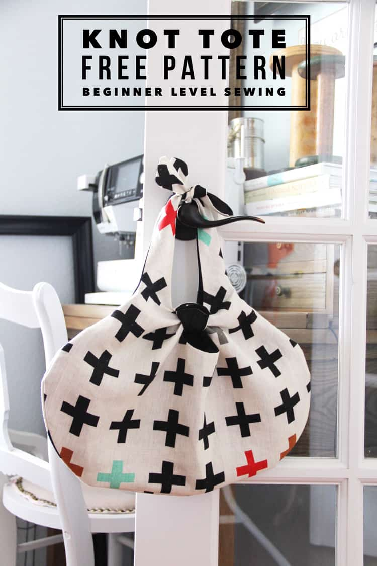 white purse with black and white swiss cross pattern