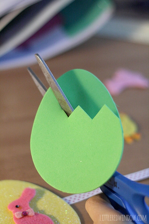 green foam egg shape cut in half in a zig zag