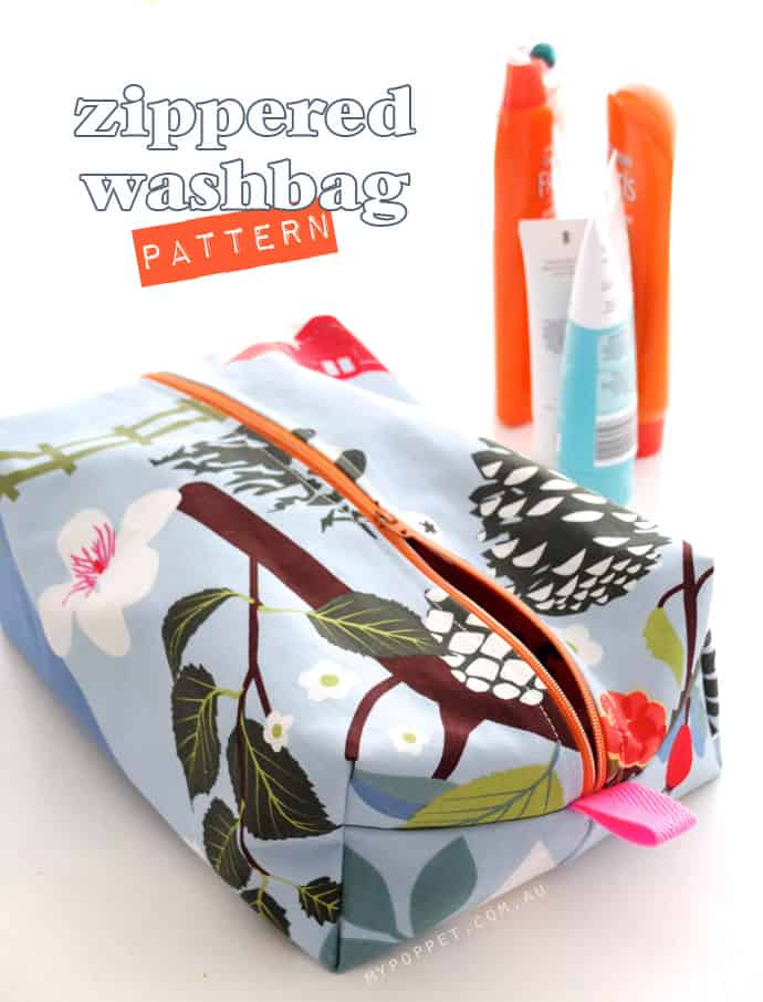 blue floral cosmetic bag with orange zipper