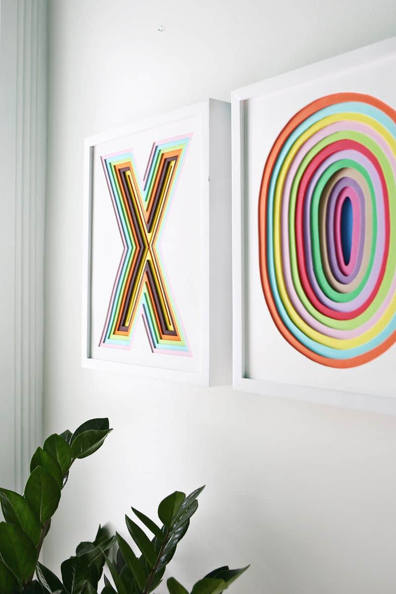 Two picutures made of 3D stacked paper letters X and O