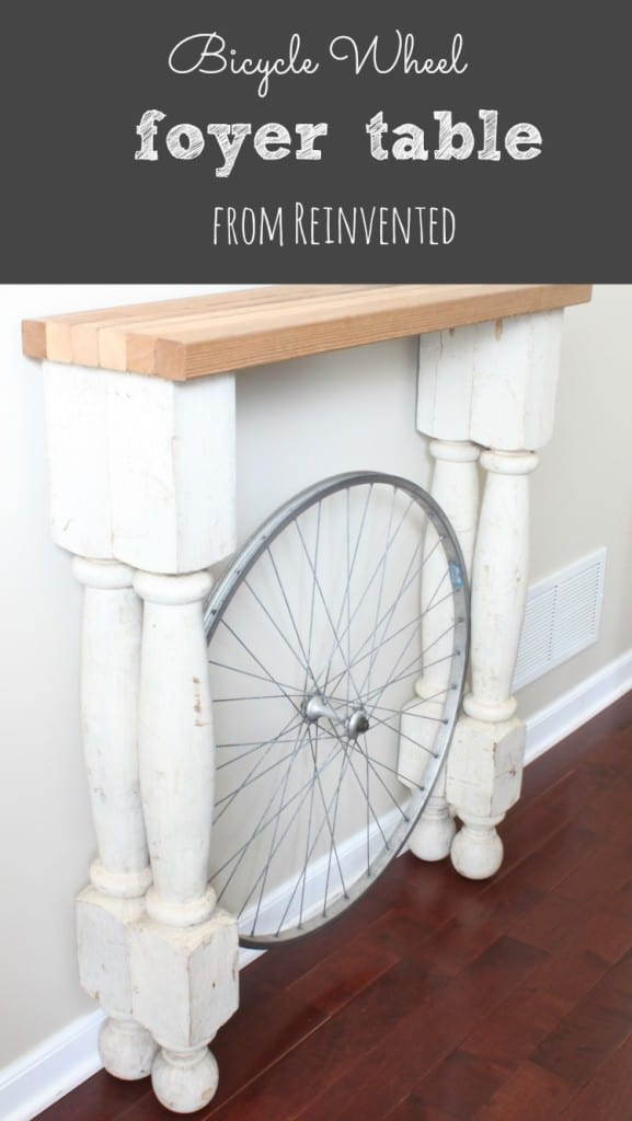 console table with bicycle wheel underneath