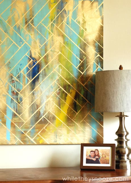 Abstract blue and green art with gold herringbone pattern on top