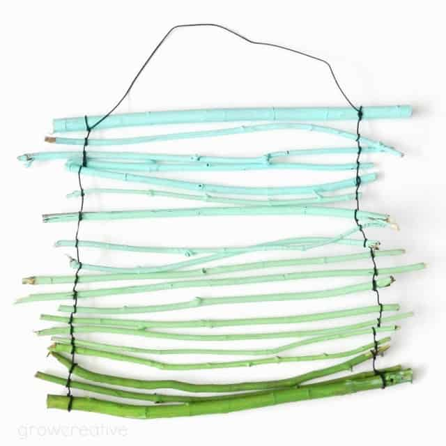 twig wall hanging painted blue to green ombre