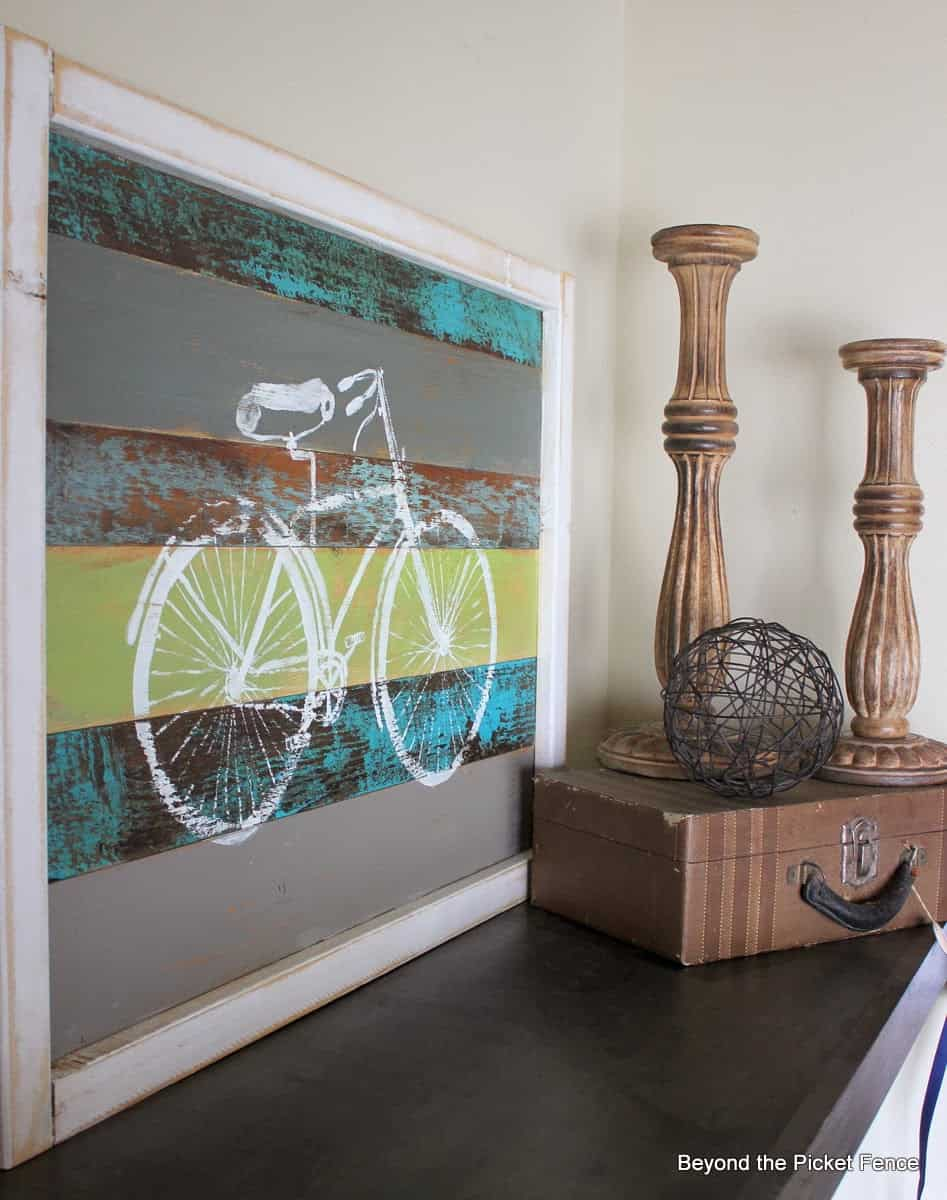 vintage wood board art with white stenciled bicycle