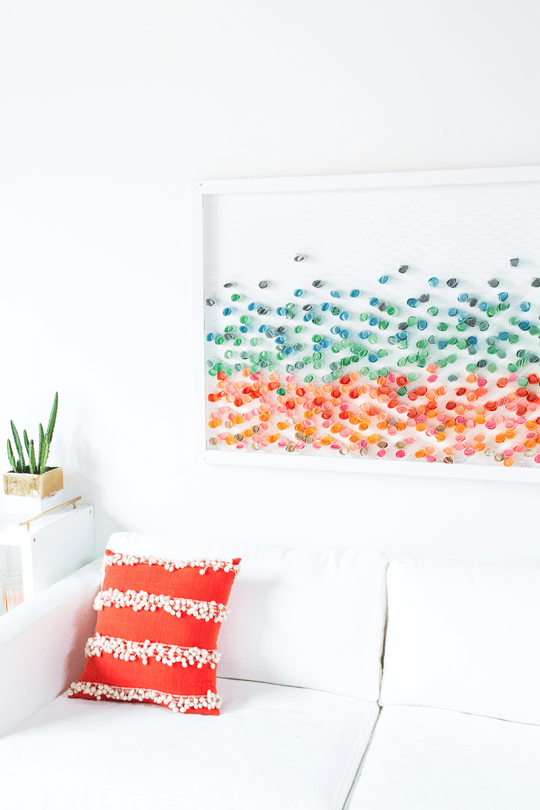 Wall art made of colorful floating dots on glass