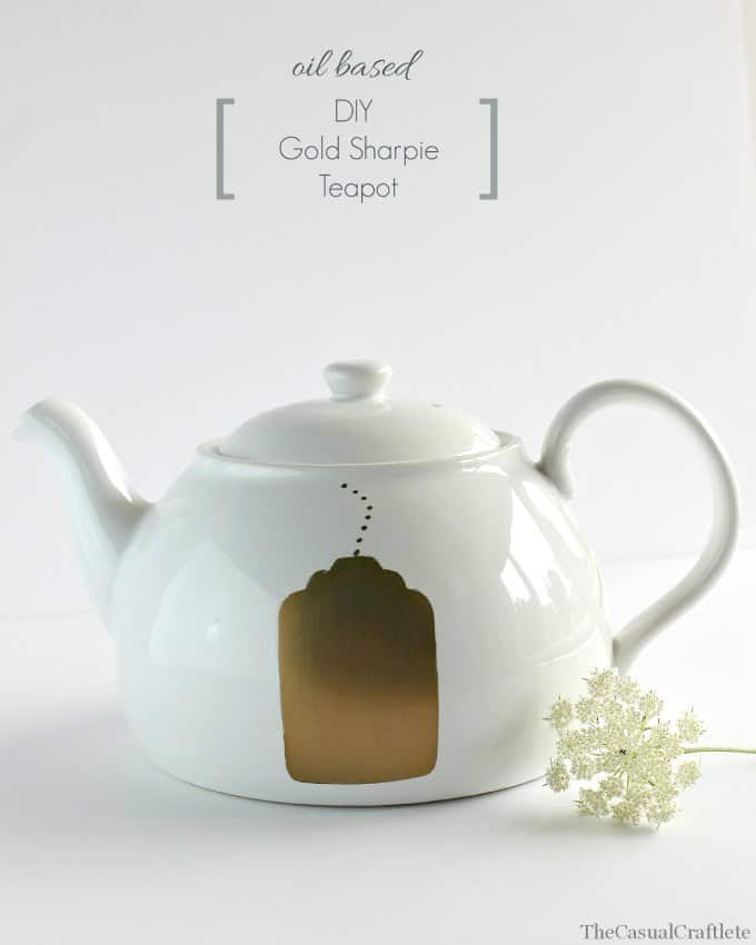 White teapot with gold teabag tag shape painted on the side