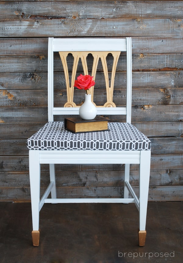 white chair with back and feet painted gold