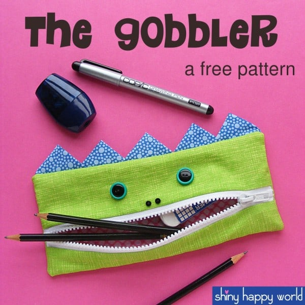 green zipper pouch that looks like a monster
