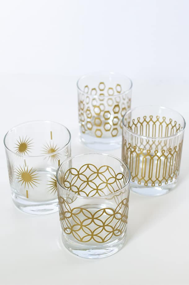 short drinking glasses with gold geometric patterns on them