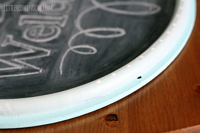 White dots added to blue frae of chalkboard sign