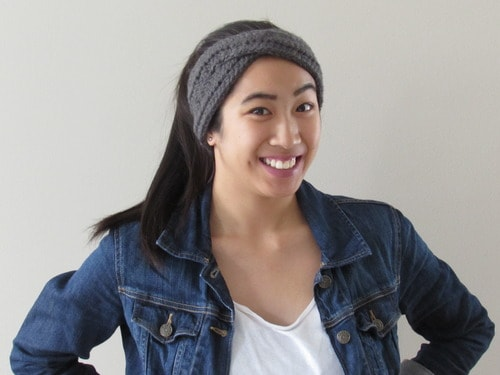 woman wearing gray crochet headband