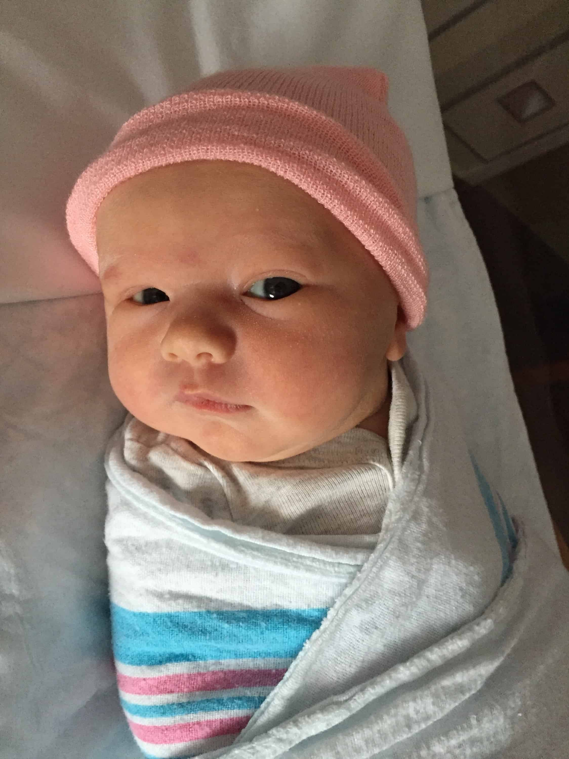 newborn baby in pink hat