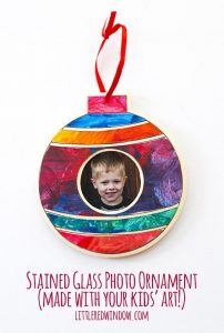 Use your kids' artwork to make this beautiful stained glass photo ornament for Christmas!