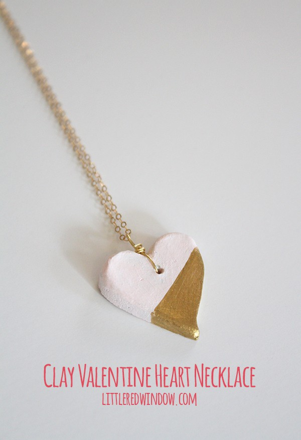 clay heart pendant painted half light pink and half gold on gold chain
