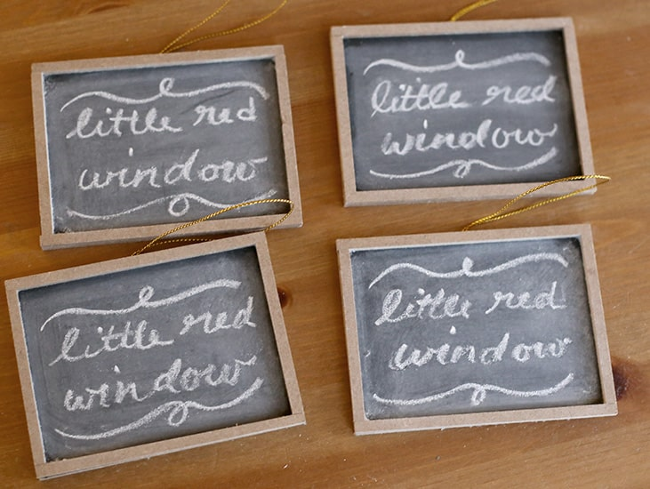 4 identical small chalkboards with chalk drawings on them that say LITTLE RED WINDOW