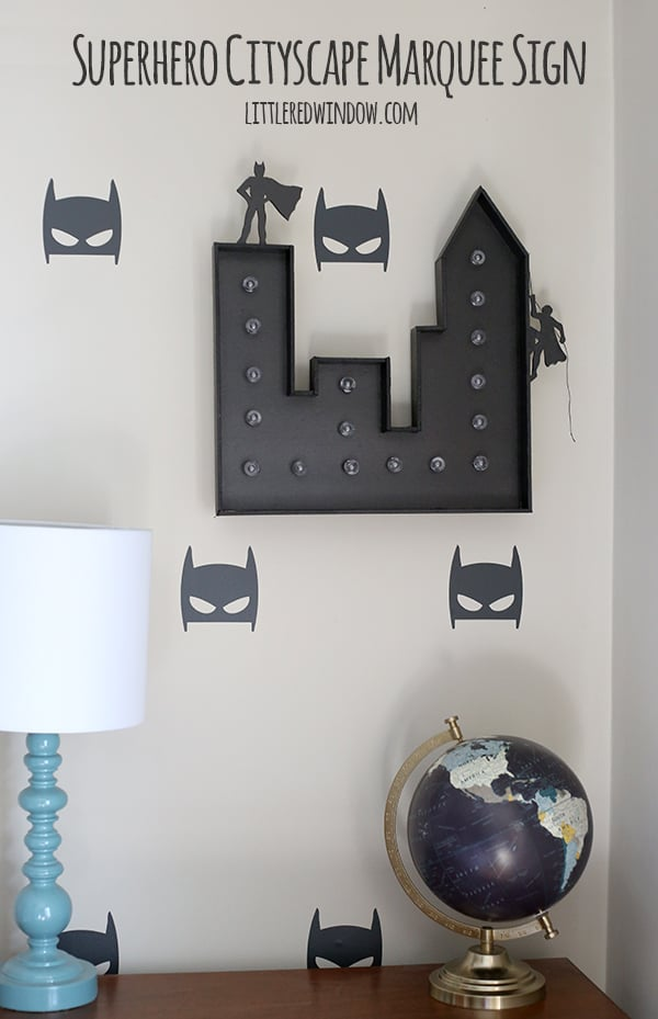 Make your own light up Superhero Cityscape Marquee Sign, your favorite superhero fan will love it! | littleredwindow.com