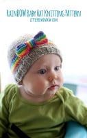 baby wearing a hat with a rainbow stripe and bow