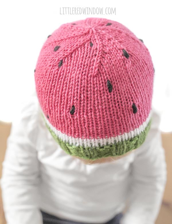 Top view of toddler wearing knit watermelon hat