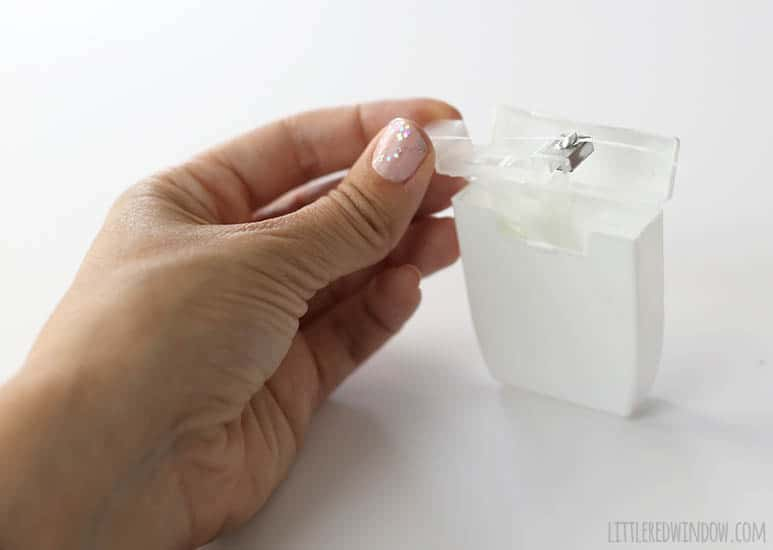 DIY Tooth Fairy Lost Tooth Box made from an old dental floss container + a FREE printable Tooth Fairy Letter! | littleredwindow.com