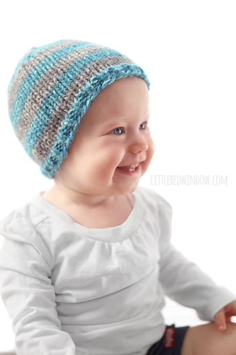 This cute blue and gray striped hat is one easy way to customize the adorable Do-Gooder baby hat knitting pattern, a free pattern that you can knit for charity!