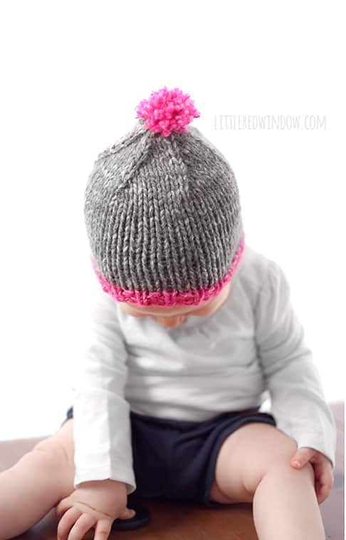 The Do-Gooder free baby hat knitting pattern is super easy to customize, it looks adorable with a contrast brim and bright pom pom on top!