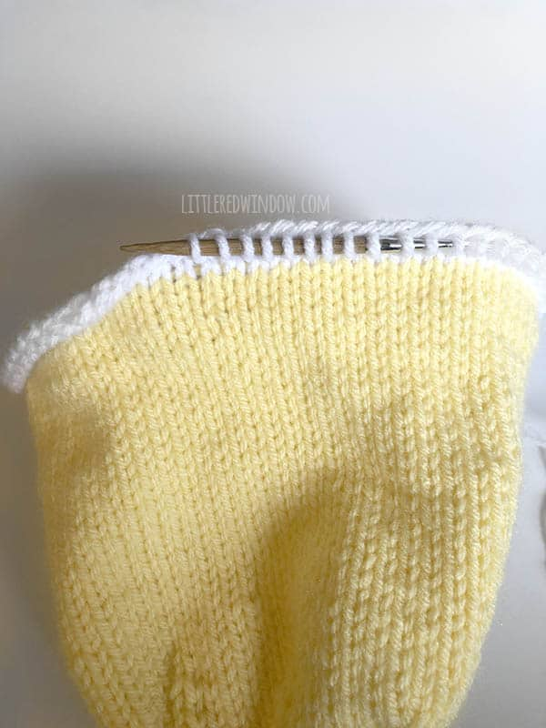 Pick up stitches to knit the eggshell brim on the Little Chick Baby Hat!