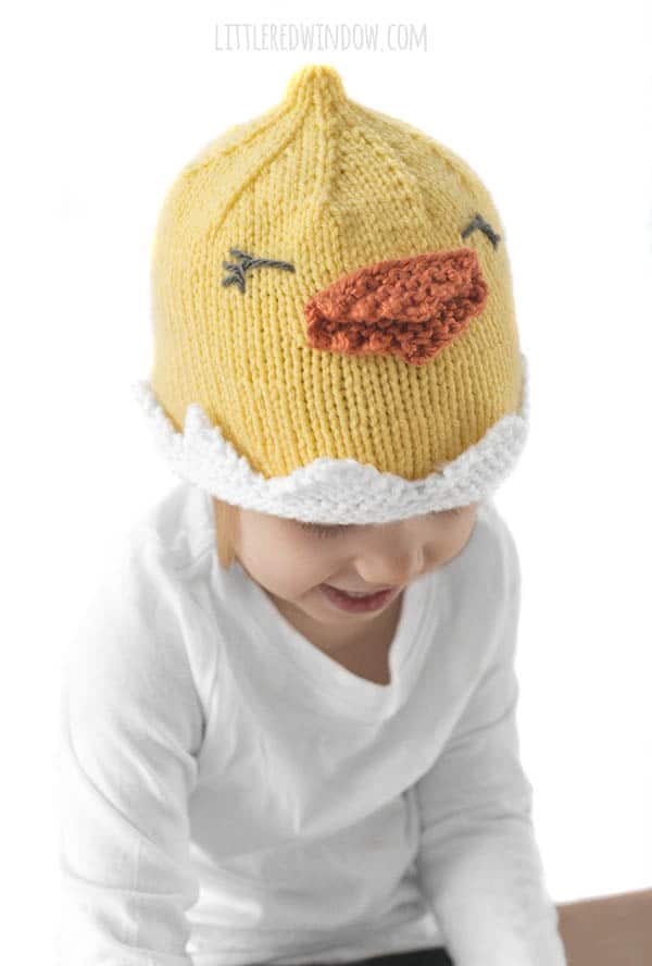 Cute knit chick hat pattern with an adorable yellow chick breaking out of its shell!