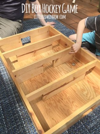 DIY Box Hockey Game with Popsicle Sticks and Bottlecap