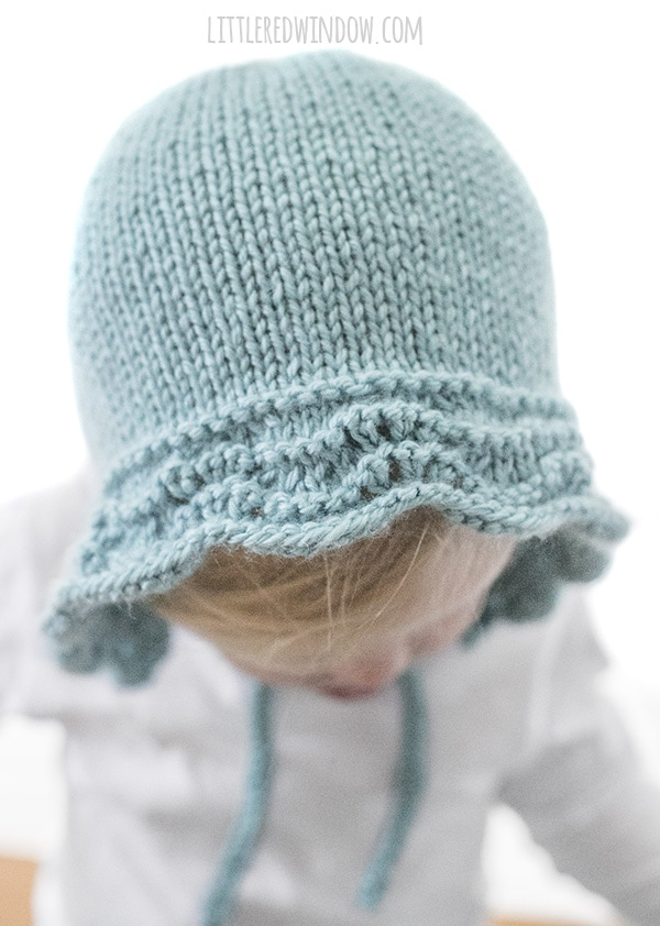 closeup view of feather and fan stitch on bluebell baby bonnet knitting pattern