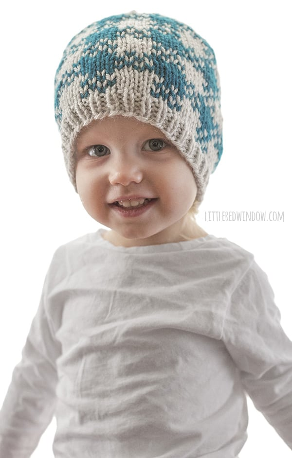 Easy Plaid Hat Knitting Pattern for newborns, babies and toddlers, this is a fun quick knit with and easy plaid pattern that only uses two colors of yarn! | littleredwindow.com