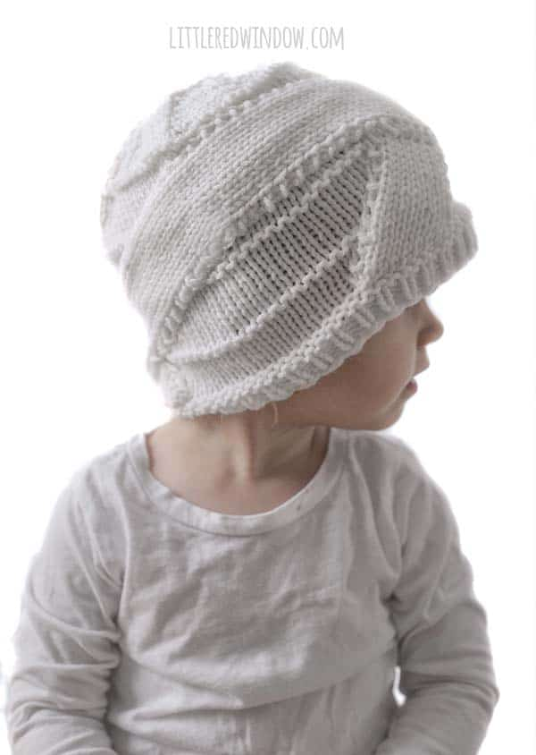 Halloween Mummy Hat Knitting Pattern, this cute hat makes for an easy DIY Halloween costume, just add a white onesie!