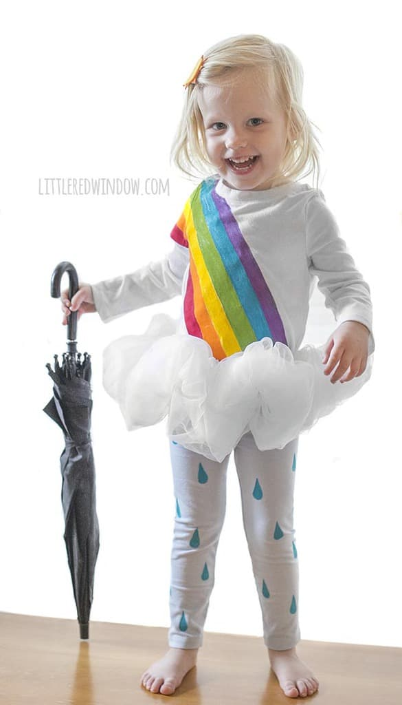 DIY Rainbow Costume for Kids! Get instructions to make this adorable costume including rainbow shirt, cloud tutu, raindrop leggins and sun hair clip!