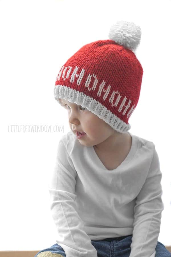 "Ho Ho Ho Santa Hat Knitting Pattern, this adorable hat says, ""Ho Ho Ho"" all around the brim, perfect to knit for your favorite baby or toddler for Christmas!"