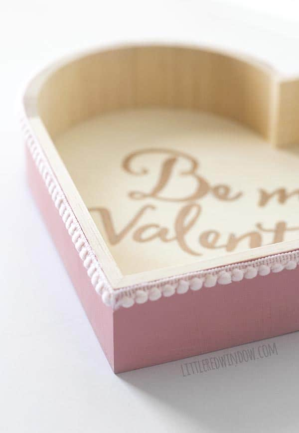 Love this closeup of the light pink pom pom trim on our DIY Valentine Pom Pom Tray!