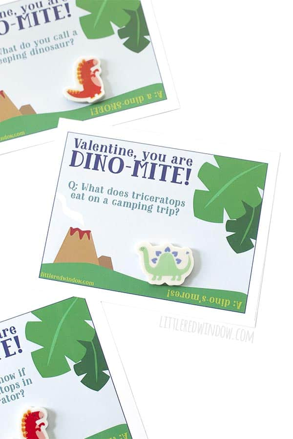 Closeup of free printable dinosaur valentines with cute green dinosaur eraser!