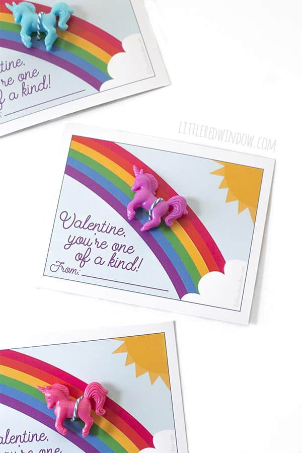Closeup of free printable unicorn valentines cards with purple unicorn toy!