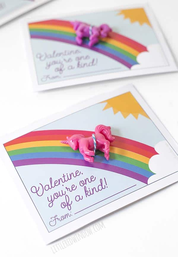 Closeup of free printable unicorn valentine with pink unicorn toy!