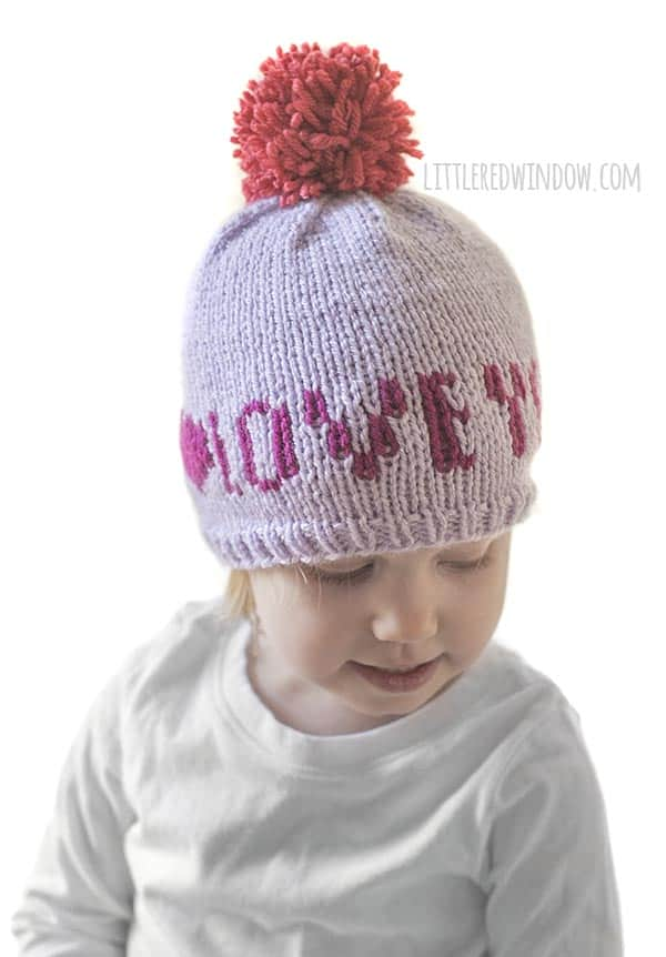 Cute baby wearing Valenting Love Notes Hat knitting pattern!