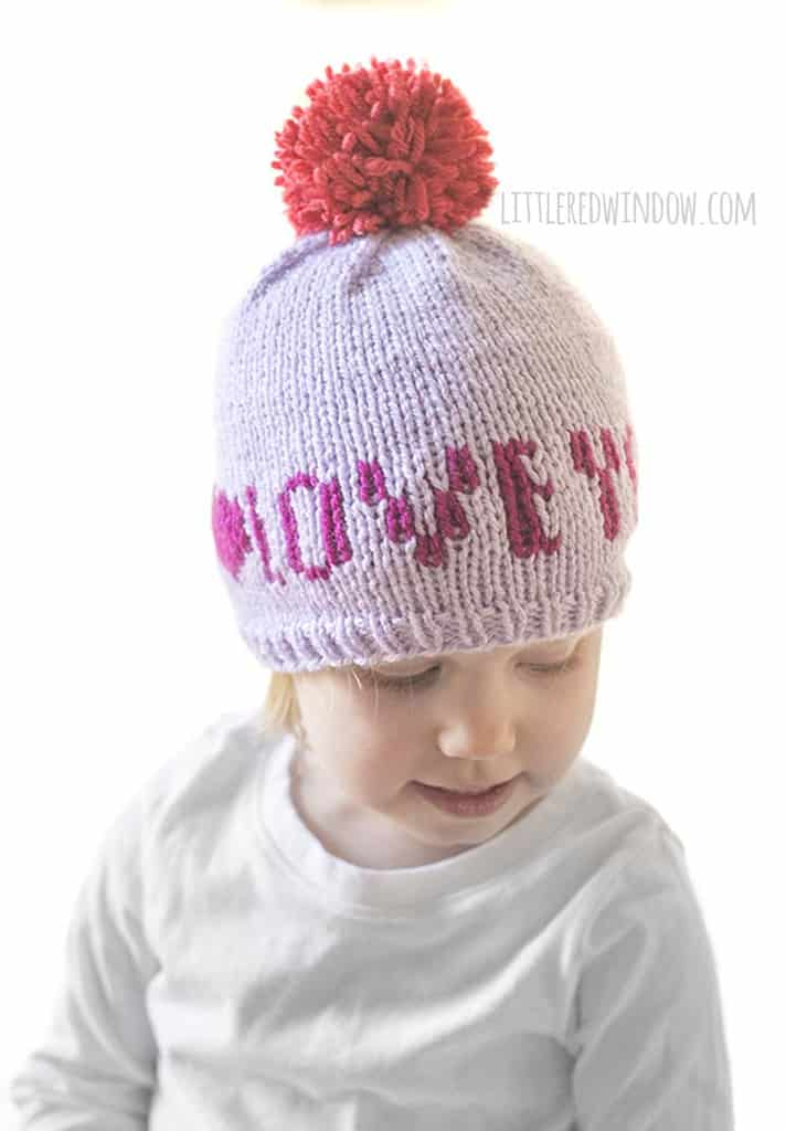 "Adorable Valentine's Day baby hat that says ""Love You"" on the front!"