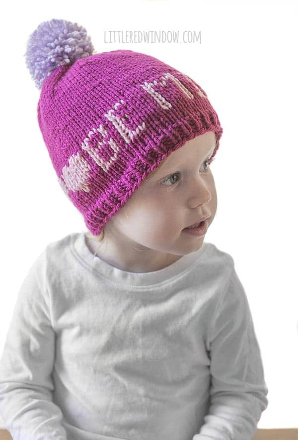 Cute baby wearing Valentine Love Notes Hat knitting pattern!