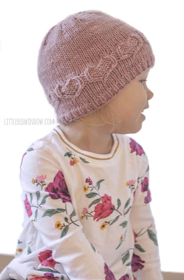 Baby showing off Valentine Sweetheart Hat knitting pattern!