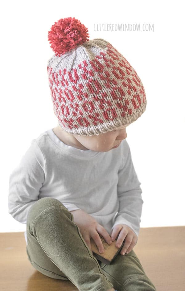 Baby playing in Valentine Tic Tac Toe Hat knitting pattern!