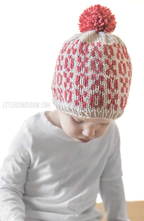 Toddler showing off Valentine Tic Tac Toe Hat knitting pattern!